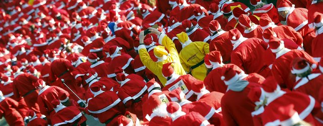 Runners dressed as Father Christmas start the Nikolaus Lauf (Santa Claus Run) in the east German town of Michendorf, southwest of Berlin, Germany, December 6, 2015. (Photo by Hannibal Hanschke/Reuters)