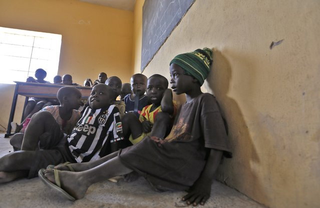 Children displaced as a result of Boko Haram attack in the northeast region of Nigeria, attend a class at Maikohi secondary school camp for internally displaced persons (IDP) in Yola, Adamawa State January 13, 2015. (Photo by Afolabi Sotunde/Reuters)
