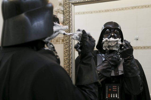 Darth Mykolaiovych Vader, who is dressed as the 'Star Wars' character Darth Vader, poses for a picture as he pretends to shave in a bathroom at his apartments in Odessa, December 2, 2015. (Photo by Valentyn Ogirenko/Reuters)