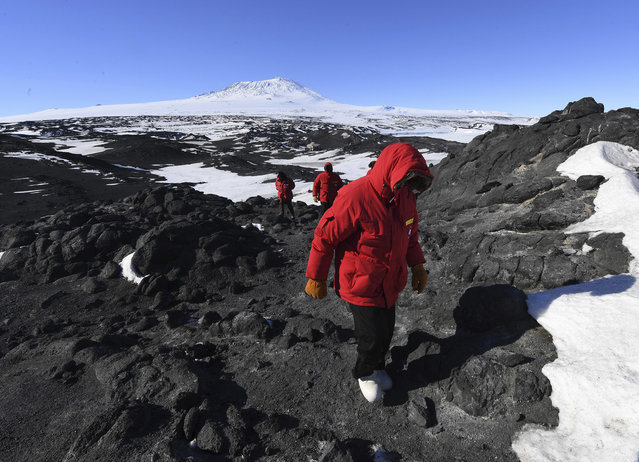 U.S. Secretary of State John Kerry hikes in front of Mount Erebus after visiting the historic Shackleton hut near McMurdo Station, Antarctica on Friday, November 11, 2016. (Photo by Mark Ralston/Pool Photo via AP Photo)