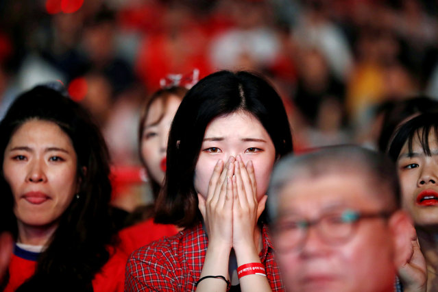A woman reacts during the broadcast of the World Cup Group F soccer match between Germany and South Korea, in central Seoul, South Korea, June 27, 2018. (Photo by Kim Hong-Ji/Reuters)