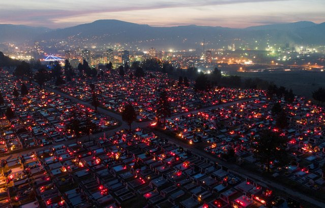 Aerial view of cemetery on Crkvicko hill during All Saints' Day in Zenica, Bosnia and Herzegovina on November 1, 2020. (Photo by Dado Ruvic/Reuters)