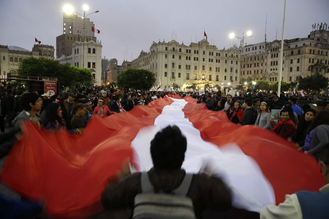 Demonstrators protest against corruption at San Martin plaza, in Lima, Peru, Thursday, July 19, 2018. The latest scandal to embroil this South American nation has ensnared some of the country's highest-ranking judges and political officials and comes just four months after then-President Pedro Pablo Kuczynski stepped down in a separate corruption probe. (Photo by Martin Mejia/AP Photo)