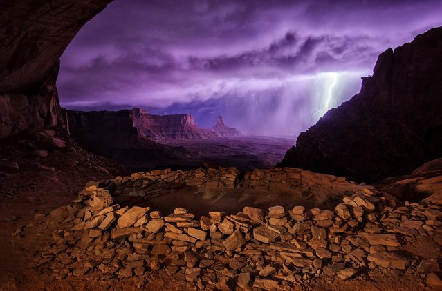 "Second Place Winner: ""Thunderstorm at False Kiva"". I hiked out to these ruins at night hoping to photograph them with the Milky Way, but instead a thunderstorm rolled through, creating this dramatic image. – Max Seigal. (Photo and caption by Max Seigal/National Geographic Traveler Photo Contest)"