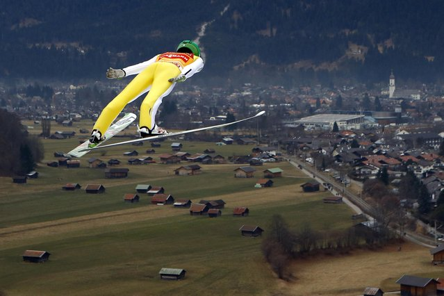 Slovenia's Peter Prevc soars through the air during his trial jump at the second stage of the 64th four hills ski jumping tournament in Garmisch-Partenkirchen, Germany, Thursday, December 31, 2015. (Photo by Matthias Schrader/AP Photo)