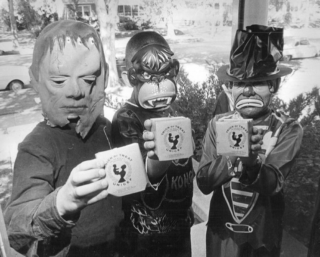 Behind those fearsome masks are Danny Hess, Dale Helzer and Cindy Gilbaugh, all 10, who will be among Greeley, Colo., school pupils working for UNICEF on Halloween in 1963. (Photo by The Denver Post)