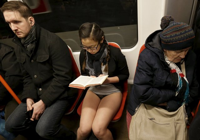 """A passenger not wearing pants sits in a subway train during the """"No Pants Subway Ride"""" in Prague, Czech Republic, January 10, 2016. (Photo by David W. Cerny/Reuters)"""