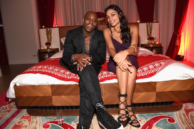 Comedian Dave Chappelle (L) and actress Rosario Dawson attend as Bulgari supports Madonna's evening of music, art, mischief and performance to benefit Raising Malawi with an after party at Faena Hotel on December 3, 2016 in Miami Beach, Florida. (Photo by Kevin Mazur/Getty Images for Bulgari)