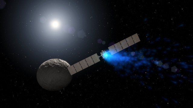 This artist rendering by NASA shows the Dawn spacecraft orbiting the dwarf planet Ceres. New findings presented at the American Geophysical Union meeting on Thursday, December 15, 2016 show that ice can exist in permanently shadowed craters on Ceres and is widespread below the surface. Dawn has been studying Ceres since 2015 after a stop at the asteroid Vesta. (Photo by NASA via AP Photo)