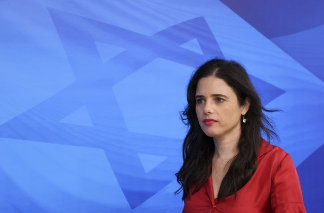 """Israeli Minister of Interior Ayelet Shaked arrives for the first weekly cabinet meeting of the new government in Jerusalem, Sunday, June 20, 2021. Prime Minister Naftali Bennett opened his first Cabinet meeting on Sunday since swearing in his new coalition government with a condemnation of the newly elected Iranian president, whom he called """"the hangman of Tehran"""". (Photo byu Emmanuel Dunand/Pool Photo via AP Photo)"""