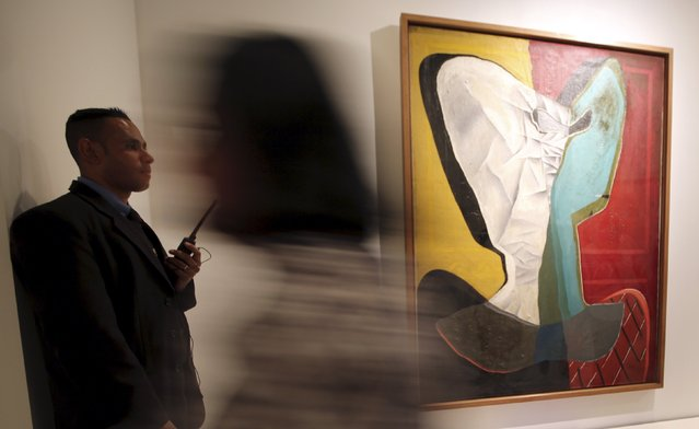 """People pass by the painting """"Reclining Figure II"""" from 1936 by Spanish artist Julio Gonzalez at the exhibition """"Picasso and the Spanish Modernity"""" at Centro Cultural Banco do Brazil in Sao Paulo March 25, 2015. (Photo by Paulo Whitaker/Reuters)"""
