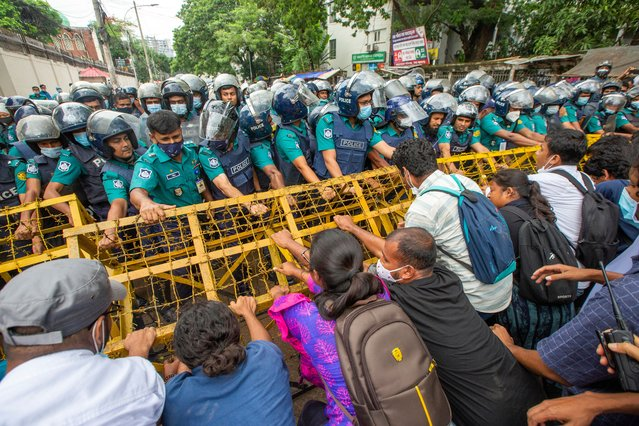 Students supporting Bangladesh's leftist party try to removes a police barricade as they march towards the Education Ministry in Dhaka, Bangladesh, 16 June 2021. The protesters demand that the government reopen all educational Institute in Bangladesh among other things, as stated in their four points press release. (Photo by Monirul Alam/EPA/EFE)