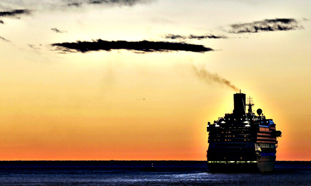A cruise ship sails out from Trieste harbor, northern Italy, at sunset, Monday, November 25, 2013. (Photo by Luca Bruno/AP Photo)