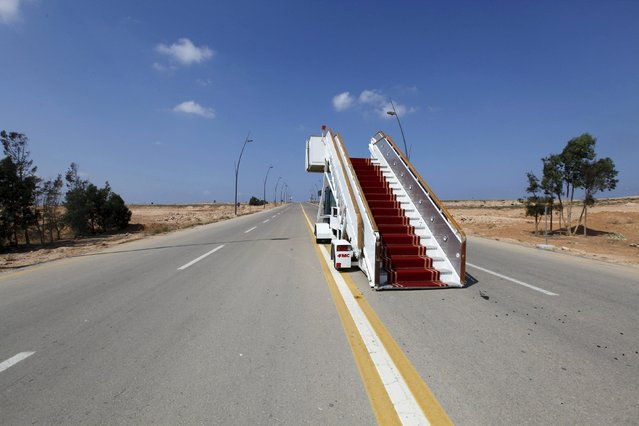 An abandoned VIP stairway is seen on a road at the airport in Sirte, which is now under the control of anti- Gaddafi fighters, September 29, 2011. (Photo by Anis Mili/Reuters)