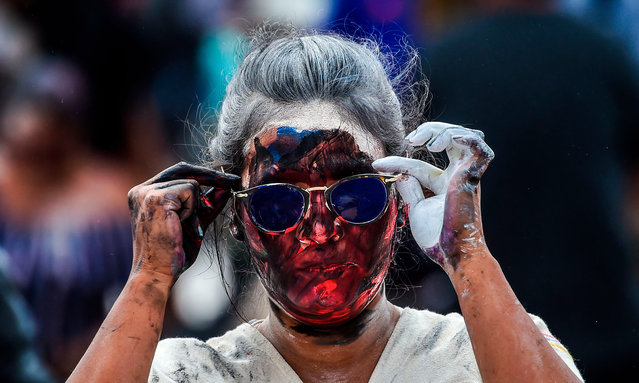 A woman gestures during the Blacks and Whites Carnival, the largest festivity in the southwestern region of the country, in Pasto, Colombia, on January 5, 2019. More than 10,000 artists, craftsmen and revellers take part in the Black and White Carnival, which has its origins in a mix of Andean, Amazonian and Pacific cultural expressions. It is celebrated every year from January 2 to 6 in the city of Pasto and has been on UNESCO's list of intangible cultural heritage since 2009. (Photo by Juan Barreto/AFP Photo)
