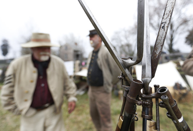 Confederate re-enactors practice stacking their arms as part of the commemoration of the 150th anniversary of the surrender of the Army of Northern Virginia at Appomattox Court House in Appomattox, Va., Thursday, April 9, 2015. (Photo by Steve Helber/AP Photo)