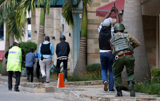 Members of security forces are seen at the scene where explosions and gunshots were heard at the Dusit hotel compound, in Nairobi, Kenya on January 15, 2019. (Photo by Thomas Mukoya/Reuters)