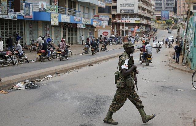 An Ugandan soldier patrols a street in Kampala, Uganda February 20, 2016. (Photo by Goran Tomasevic/Reuters)