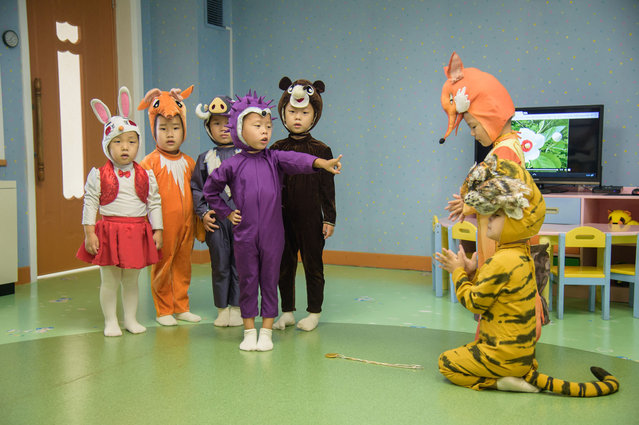 """Children perform a fairy tale entitled """"The Hedgehog Defeats the Tiger"""" at the Pyongyang Baby Home in Pyongyang on September 2, 2021. (Photo by Kim Won Jin/AFP Photo)"""