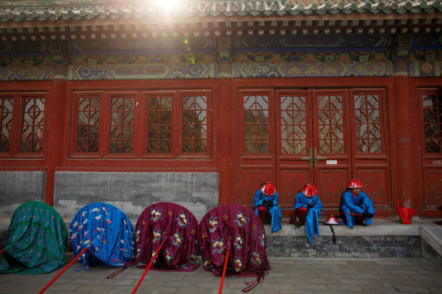 Performers rest after a rehearsal of a re-enactment of a Chinese New Year Qing Dynasty ceremony at the Temple of Earth in Ditan Park in Beijing, China, February 4, 2019. (Photo by Thomas Peter/Reuters)