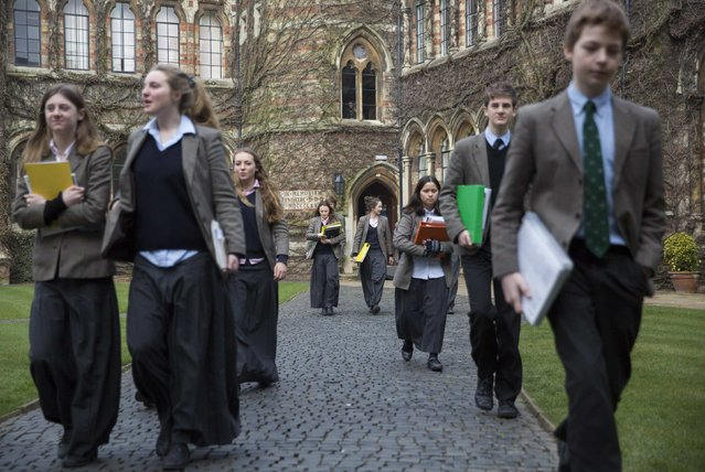 Pupils walk to lessons at Rugby School in central England, March 18, 2015. (Photo by Neil Hall/Reuters)