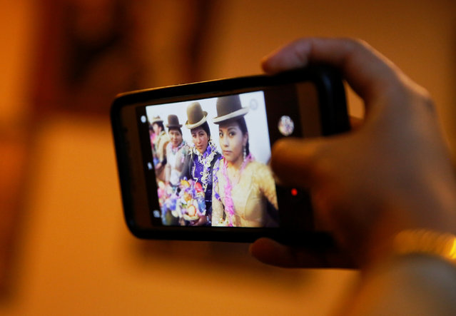 A Cholita (Andean woman) model takes a selfie with her mobile phone after a practice session at the Rosario Aguilar fashion model school in La Paz, Bolivia, February 23, 2019. (Photo by David Mercado/Reuters)