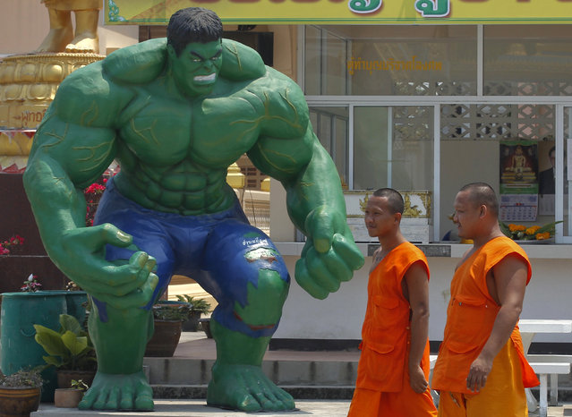 Buddhist monks walk past a statue of comic character the Hulk at Tamru temple in Samut Prakan province, Thailand, March 3, 2016. (Photo by Chaiwat Subprasom/Reuters)