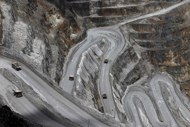 Trucks operate in the open-pit mine of PT Freeport's Grasberg copper and gold mine complex near Timika, in the eastern region of Papua, Indonesia September 19, 2015. (Photo by Muhammad Adimaja/Reuters)