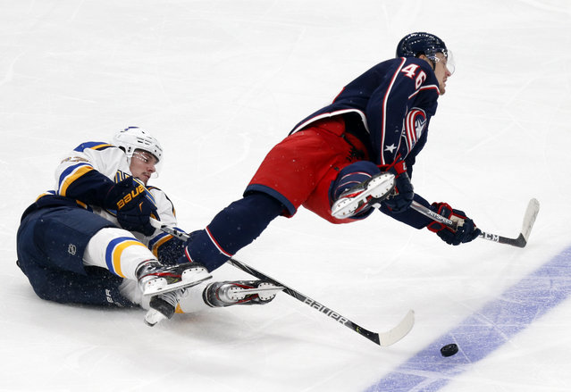 St. Louis Blues forward Klim Kostin, left, gets tangled with Columbus Blue Jackets defenseman Dean Kukan during the second period of a preseason NHL hockey game in Columbus, Ohio, Wednesday, September 29, 2021. (Photo by Paul Vernon/AP Photo)