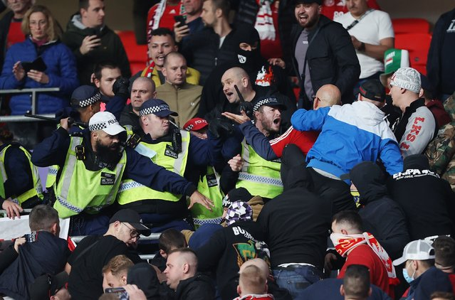 Police clash with Hungary fans during the 2022 FIFA World Cup Qualifier match between England and Hungary at Wembley Stadium on October 12, 2021 in London, England. (Photo by Charlotte Wilson/Offside/Offside via Getty Images)
