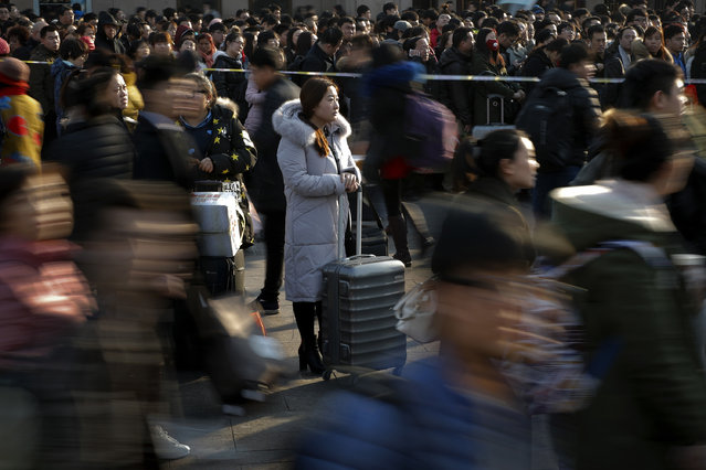 Passengers crowd outside the Beijing railway station on the last day of Chinese Lunar New Year holidays in Beijing, Thursday, February 2, 2017. Millions of Chinese are returning to work in the capital city after spending a week-long Lunar New Year holiday with families in their hometown. (Photo by Andy Wong/AP Photo)