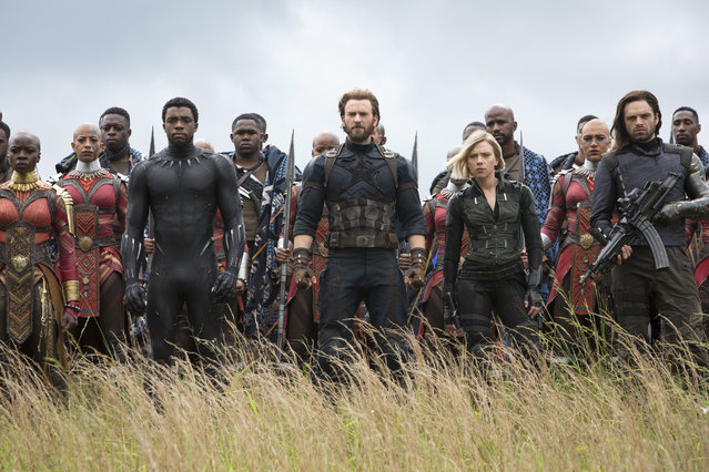 "This image released by Marvel Studios shows, front row from left, Danai Gurira, Chadwick Boseman, Chris Evans, Scarlet Johansson and Sebastian Stan in a scene from ""Avengers: Infinity War"". After a down year in 2017, the box office has been back in a big way, and headed toward a record, thanks to the massive successes of films like Disney's ""Black Panther"", ""Avengers: Infinity War"" and ""Incredibles 2"". (Photo by Chuck Zlotnick/Marvel Studios via AP Photo)"