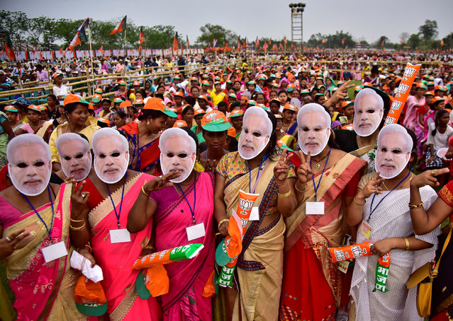 Supporter of India's ruling Bharatiya Janata Party (BJP) wearing masks of Prime Minister Narendra Modi attend an election campaign rally addressed by Modi at Moran town in the northeastern state of Assam, India, March 30, 2019. (Photo by Anuwar Hazarika/Reuters)