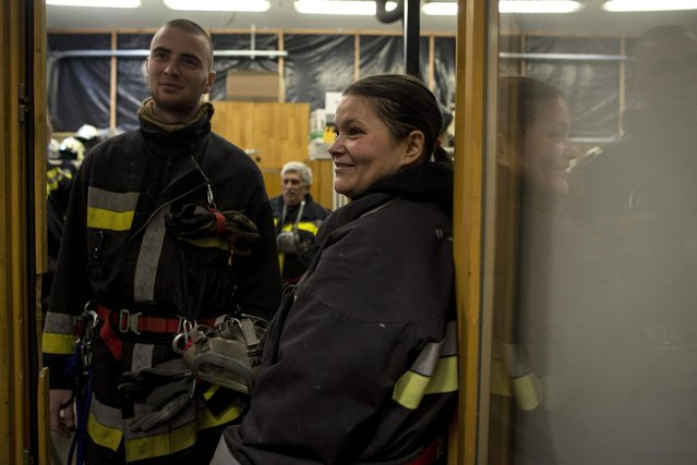 Volunteer firefighter Eniko Nagy (R) stands with her colleagues in the Budaors Fire Services Department building in Budaors, a south western suburb of Budapest, Hungary, 05 March 2016. (Photo by Bea Kallos/EPA)