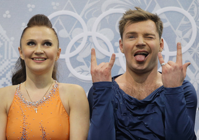 Julia Zlobina and Alexei Sitnikov of Azerbaijan gesture as they wait in the results area after competing in the ice dance free dance figure skating finals at the Iceberg Skating Palace during the 2014 Winter Olympics, Monday, February 17, 2014, in Sochi, Russia. (Photo by Vadim Ghirda/AP Photo)