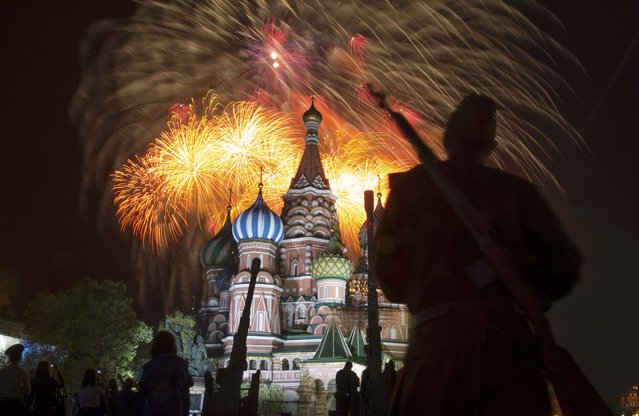Fireworks explode over Red Square, with St. Basil's Cathedral seen on the background, during the Victory Day celebrations in Moscow, Russia, May 9, 2015. (Photo by Maxim Shemetov/Reuters)