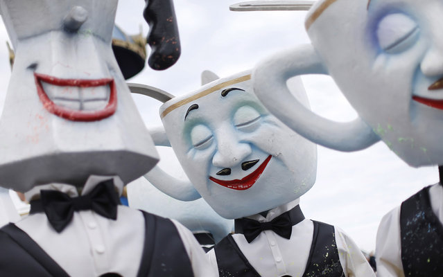 """Dancers parade during the Nice Carnival on February 25, 2014 in Nice, southeastern France. The theme of this year's carnival, running from February 14 until March 4, 2014, is the """"King of Gastronomy"""". (Photo by Valery Hache/AFP Photo)"""