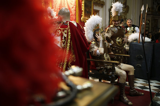 Participants dressed as Roman soldiers wait inside St Philip Church before a Good Friday procession in the village of Zebbug, outside Valletta, Malta, March 25, 2016. (Photo by Darrin Zammit Lupi/Reuters)