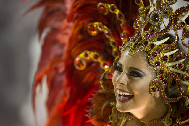 A performer from the Imperio da Tijuca samba school parades on a float during carnival celebrations at the Sambadrome in Rio de Janeiro, Brazil, Sunday, March 2, 2014. (Photo by Felipe Dana/AP Photo)