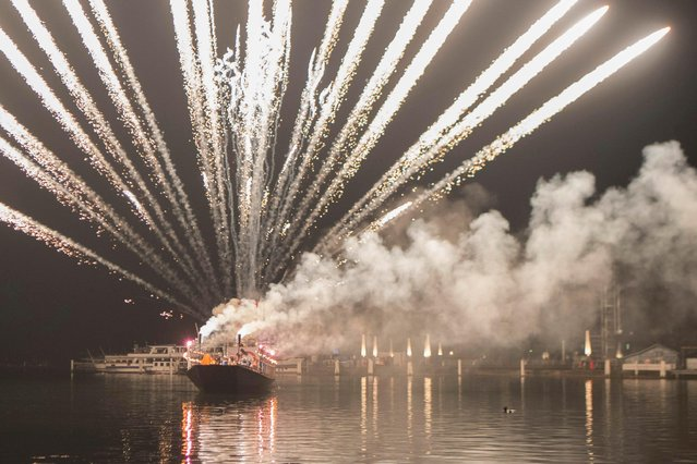 Fireworks are displayed to mark the 'Urknall' (Big Bang), which initiates at 5 o'clock in the morning, during the Fasnacht Carnival of Lucerne, Switzerland, early 23 February 2017. (Photo by Urs Flueeler/EPA)