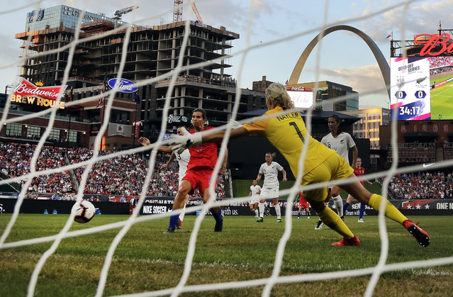 United States forward Tobin Heath, left, scores past New Zealand goalkeeper Erin Nayler during the first half of an international friendly soccer match Thursday, May 16, 2019, in St. Louis. (Photo by Jeff Roberson/AP Photo)