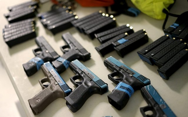 Glock semi-automatic pistols modified to shoot Simunition non-lethal training ammunition are ready for an Active Shooter Response course offered by TAC ONE Consulting in Denver April 2, 2016. (Photo by Rick Wilking/Reuters)