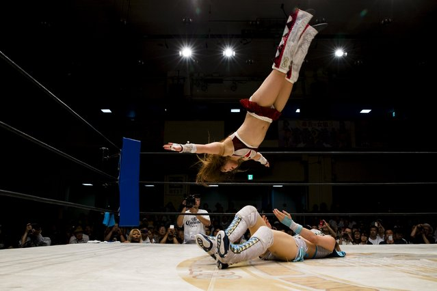 Io Shirai (top) performs a moonsault onto Mayu Iwatani during their Stardom professional wrestling show at Korakuen Hall in Tokyo, Japan, July 26, 2015. (Photo by Thomas Peter/Reuters)