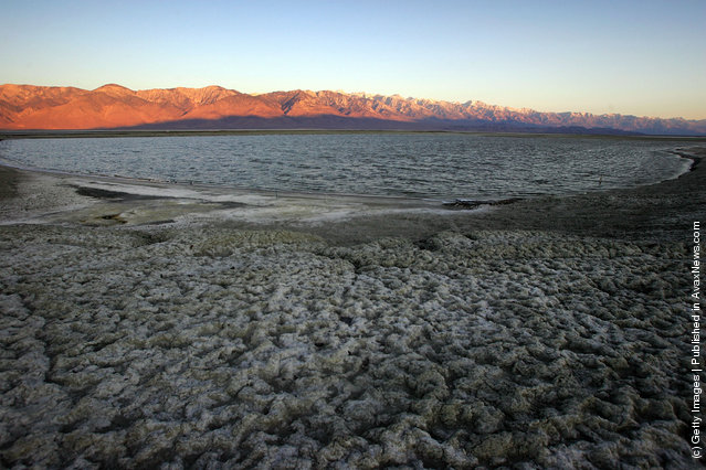 Large shallow pools of restored water cover portions the salty crust of mostly-dry Owens Lake