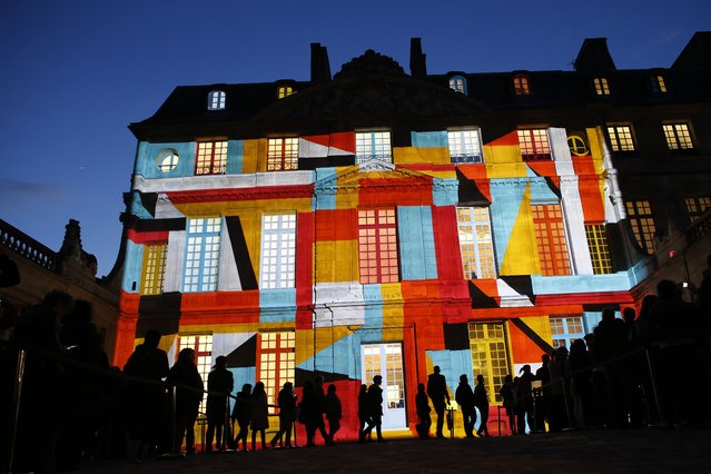 Video mapping is used to display a projection on the Hotel Sale which houses the Picasso Museum in Paris, as part of the 11th edition of the European museum night, on May 16, 2015. The European museum night was created in 2005 by the French Ministry of Culture and Communication, with the closing time of the museums postponed to approximately one in the morning, allowing the public to visit the participating museums by night, for free. (Photo by Thomas Samson/AFP Photo)