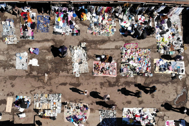 An aerial view shows a flea market in Tbilisi on April 7, 2019. (Photo by Vano Shlamov/AFP Photo)