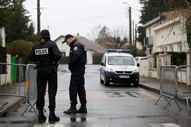 French police secure the streets around the house of the Troadec family in Orvault near Nantes, France, March 1, 2017. The couple and their two children have been missing for nearly two weeks. (Photo by Stephane Mahe/Reuters)