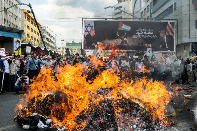 Iranians march during a protest marking the annual al-Quds Day (Jerusalem Day) on the last Friday of the holy month of Ramadan in Tehran, Iran on May 31, 2019. (Photo by Tasnim News Agency via Reuters)