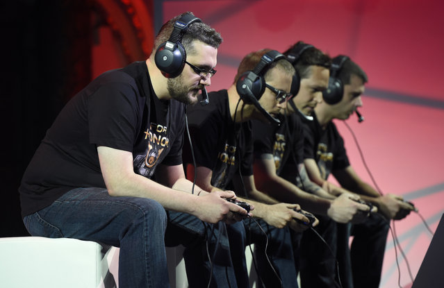 """Gamers play """"For Honor"""" onstage at Ubisoft's E3 2015 Conference at the Orpheum Theatre on Monday, June 15, 2015, in Los Angeles. (Photo by Chris Pizzello/Invision/AP)"""