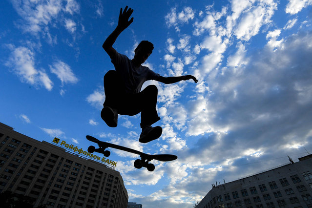 A skateboarder performs a trick in central Moscow, Russia on May 21, 2019. (Photo by Kirill Kudryavtsev/AFP Photo)